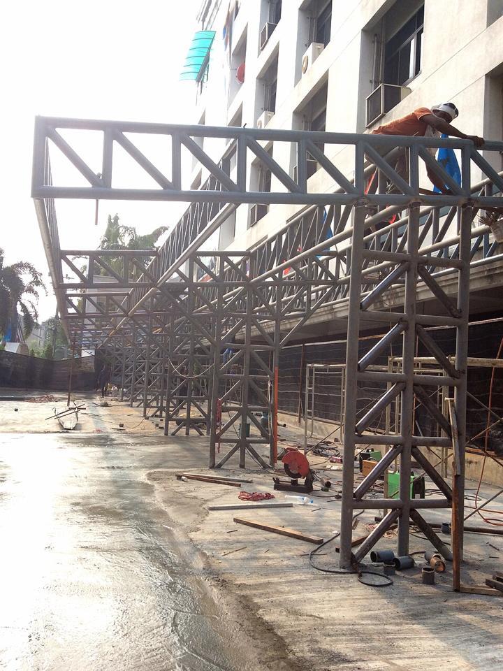 งานสร้างโรงจอดรถพร้อมเทพื้นถนน สำนักงานกรมป่าไม้